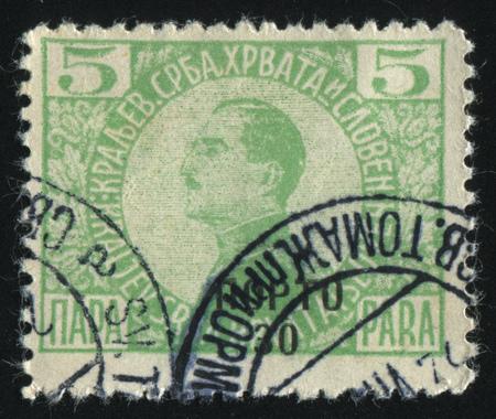 statesman: RUSSIA KALININGRAD, 12 NOVEMBER 2016: stamp printed by Yugoslavia, shows the King Alexander, circa 1921