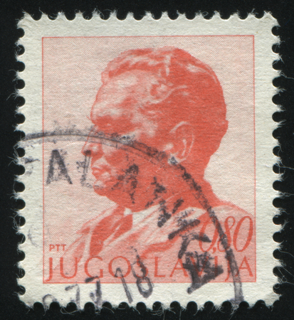 the statesman: RUSSIA KALININGRAD,12 NOVEMBER 2016: stamp printed by Yugoslavia, shows the portrait of marshal Tito, circa 1974 Editorial