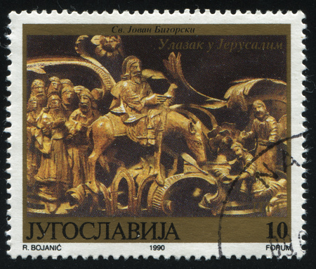 postmark: RUSSIA KALININGRAD, 12 NOVEMBER 2016: stamp printed by Yugoslavia, shows Religious carving Entry into Jerusalem, circa 1990 Editorial