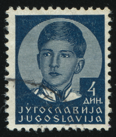 postmark: RUSSIA KALININGRAD,12 NOVEMBER 2016: stamp printed by Yugoslavia, shows the portrait of king Peter II, circa 1935