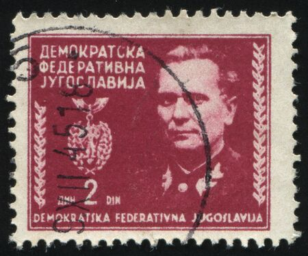 RUSSIA KALININGRAD,12 NOVEMBER 2016: stamp printed by Yugoslavia, shows the portrait of marshal Tito, circa 1945