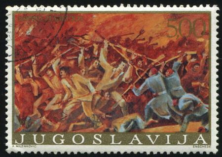 RUSSIA KALININGRAD, 12 NOVEMBER 2016: stamp printed by Yugoslavia, shows the Painting Uprisig at Razlovci by Borko Lazeski, circa 1976