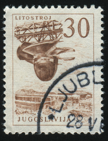 postmark: RUSSIA KALININGRAD, 12 NOVEMBER 2016: stamp printed by Yugoslavia, shows the Litostroy turbine factory, circa 1958