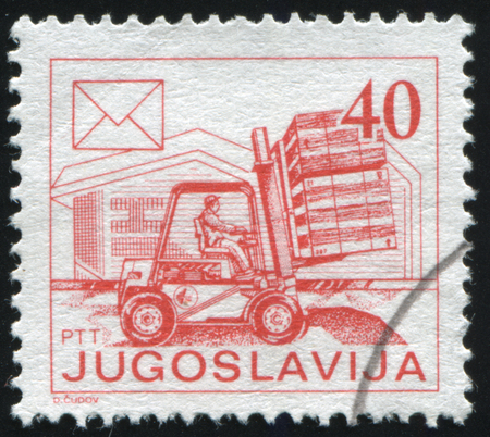 RUSSIA KALININGRAD, 12 NOVEMBER 2016: stamp printed by Yugoslavia, shows forklift and mail pallets, circa 1986 Stock Photo - 83708949