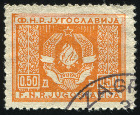 RUSSIA KALININGRAD, 12 NOVEMBER 2016: stamp printed by Yugoslavia, shows Arms of the Federated Peoples Republic, circa 1946