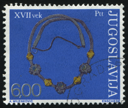 RUSSIA KALININGRAD, 12 NOVEMBER 2016: stamp printed by Yugoslavia, shows silver necklace, circa 1975 Editorial