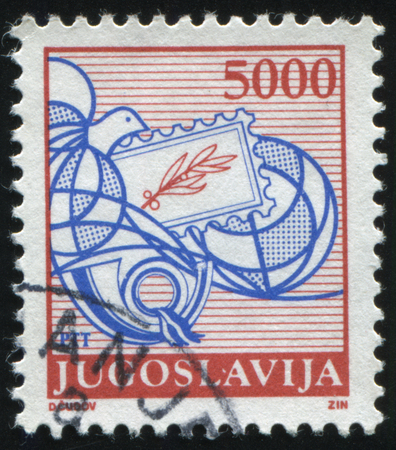 posthorn: RUSSIA KALININGRAD, 12 NOVEMBER 2016: stamp printed by Yugoslavia, shows a bird carrying the letter and posthorn, circa 1988