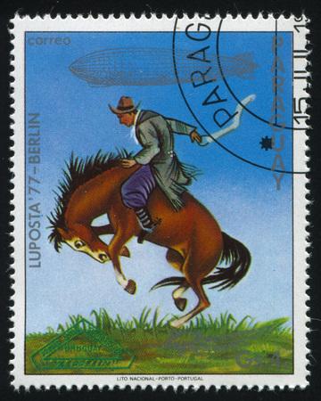 RUSSIA KALININGRAD, 22 APRIL 2017: stamp printed by Paraguay, shows  gaucho breaking bronco, Uruguay, circa 1977