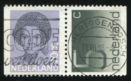 RUSSIA KALININGRAD, 27 JUNE 2017: stamp printed by Netherlands shows emblem, figure, number and symbol, circa 1981