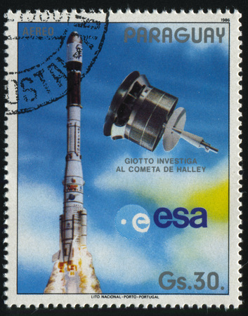 RUSSIA KALININGRAD, 22 APRIL 2017: stamp printed by Paraguay, shows spaceship Giotto for investigating of Halleys comet, circa 1986