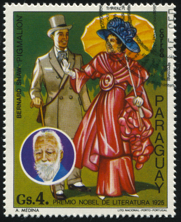 RUSSIA KALININGRAD, 19 APRIL 2017: stamp printed by Paraguay, shows the Nobel laureate for literature Bernard Show and illustration of the book Pigmalion, circa 1977 Editorial