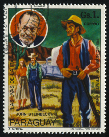 RUSSIA KALININGRAD, 19 APRIL 2017: stamp printed by Paraguay, shows the Nobel laureate for literature John Steinbeck and illustration of the book Grapes of Wrath, circa 1977