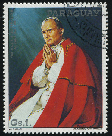 RUSSIA KALININGRAD, 19 APRIL 2017: stamp printed by Paraguay, shows Pope John Paul with hands clasped, circa 1988