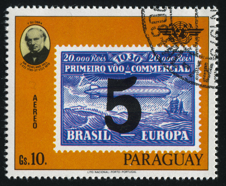 RUSSIA KALININGRAD, 22 APRIL 2017: stamp printed by Paraguay, shows Sir Rowland Hill and a stamp reproducing airship Graf Zeppelin, circa 1979 Editorial