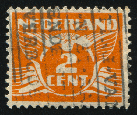 RUSSIA KALININGRAD, 21 JUNE 2017: stamp printed by Netherlands shows emblem, figure, number and symbol, circa 1924