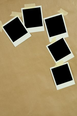 Blank Polaroid Frames on Brown paper background photo