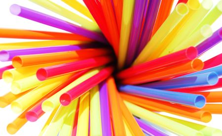 Cluster of colorful straws in a cup photo