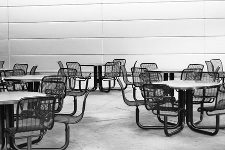 Empty chairs and tables at a restaurant photo