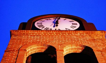 Clock Tower in the blue sky at sunset photo