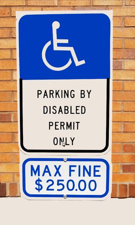 Handicap parking sign with $250 fine on it Фото со стока