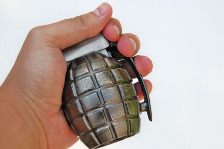 frag: Hand holding a grenade on white background Stock Photo