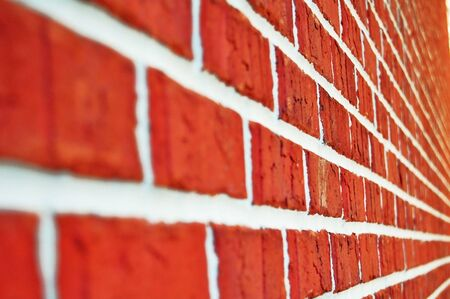 cluster house: closeup of orange brick wall