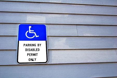 handicap sign on a wooden wall