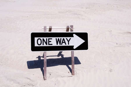one way sign on a beach