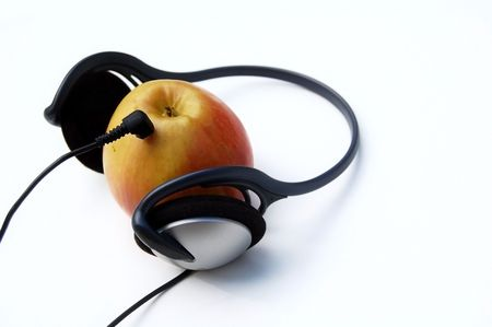 apple with headphones on white background Stock Photo