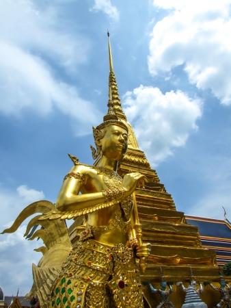 far eastern: A Golden Kinnari statue at the Temple of the Emerald Buddha  Wat Phra Kaew  , Bangkok, Thailand Stock Photo