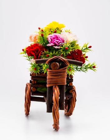 mini bike: Plastic flower on a bike vase with white background. Stock Photo