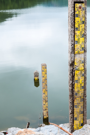 depth gauge: The old water level pole in dam.