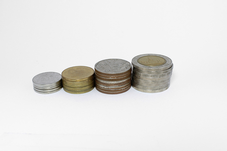 gold bar earn: Stack of Thai Bath coins on white background