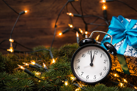 the end of the year: Christmass tree, gifts, lights and clock Stock Photo