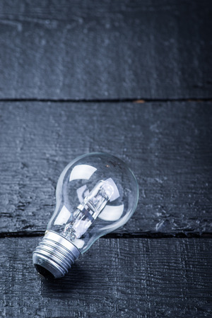 tungsten: Tungsten bulb on a black wooden table