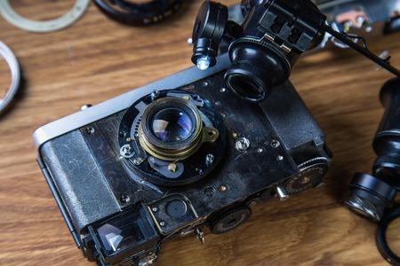 disassembled: Disassembled broken film camera