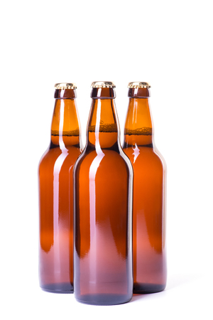 brown bottles: Three brown bottles of ice cold beer isolated on white Stock Photo