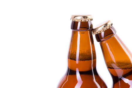 dew cap: Two brown bottles of ice cold beer isolated on white