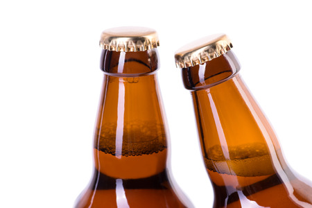 brown bottles: Two brown bottles of ice cold beer isolated on white