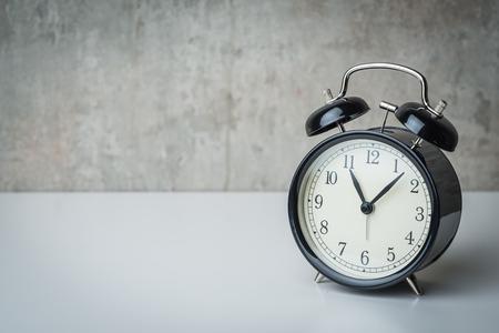 night table: Vintage alarm clock on a night table