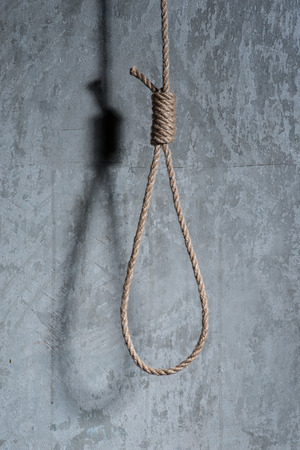 capital punishment: Hangmans loop over the concrete wall Stock Photo