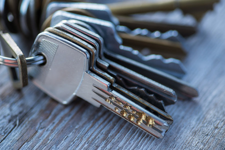 guard house: A bunch of vintage keys on the wooden table Stock Photo