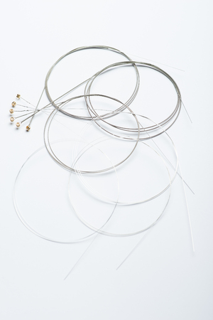 vibrate: Electric guitar strings on white surface