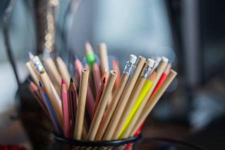 color pencils: Color pencils on the table with background lights Stock Photo