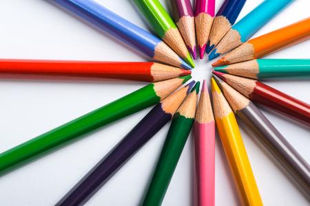colour pencils: Several color pencils on a white paper sheet Stock Photo