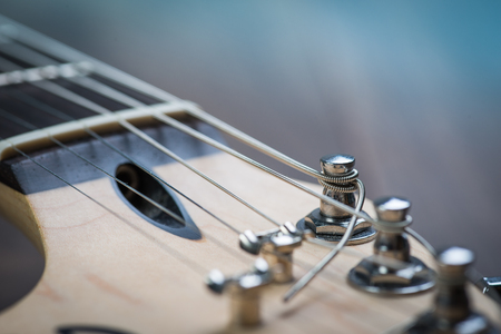 Guitar riff with strings and tuning knobs Stock Photo