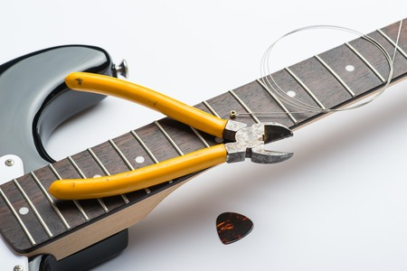 frets: Guitar frets with string, mediator and yellow nippers