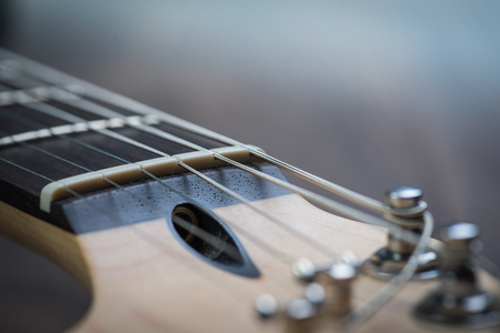 guitar tuner: Guitar riff with strings and tuning knobs Stock Photo
