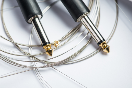 Guitar strings with cable and jacks