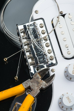 nippers: Electric guitar with yellow nippers and strings